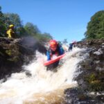 Hydrospeeding down a waterfall on the River Tees