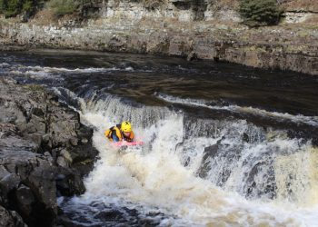 Man hydrospeeding on the rapids of the River Tees