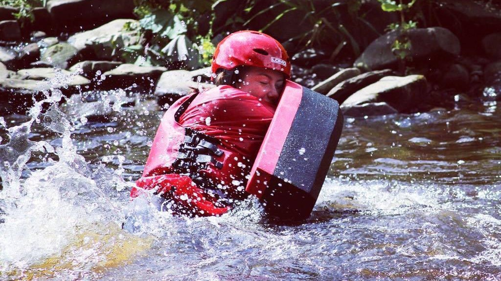 Woman hydrospeeding in the River Tees in the North Pennines