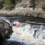 Man going down the rapids on the River Tees
