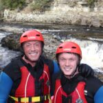 Father and son after hydrospeeding on the River Tees