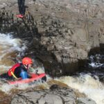 Person on hydrospeed board on the River Tees