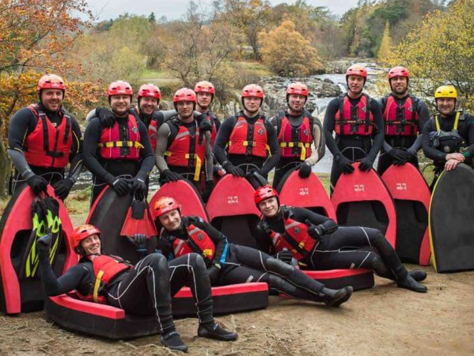 Group of men hydrospeeding on a stag do